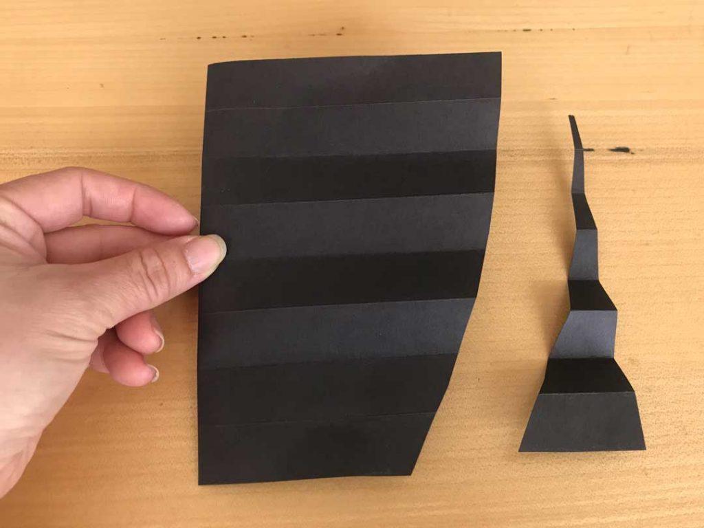 bat decoration, cut folded paper