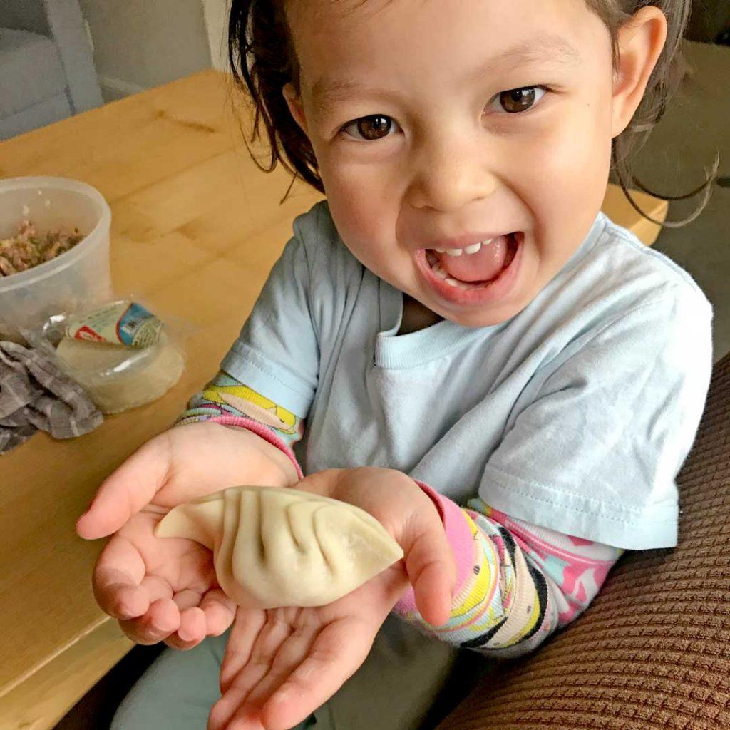 girl holding dumpling