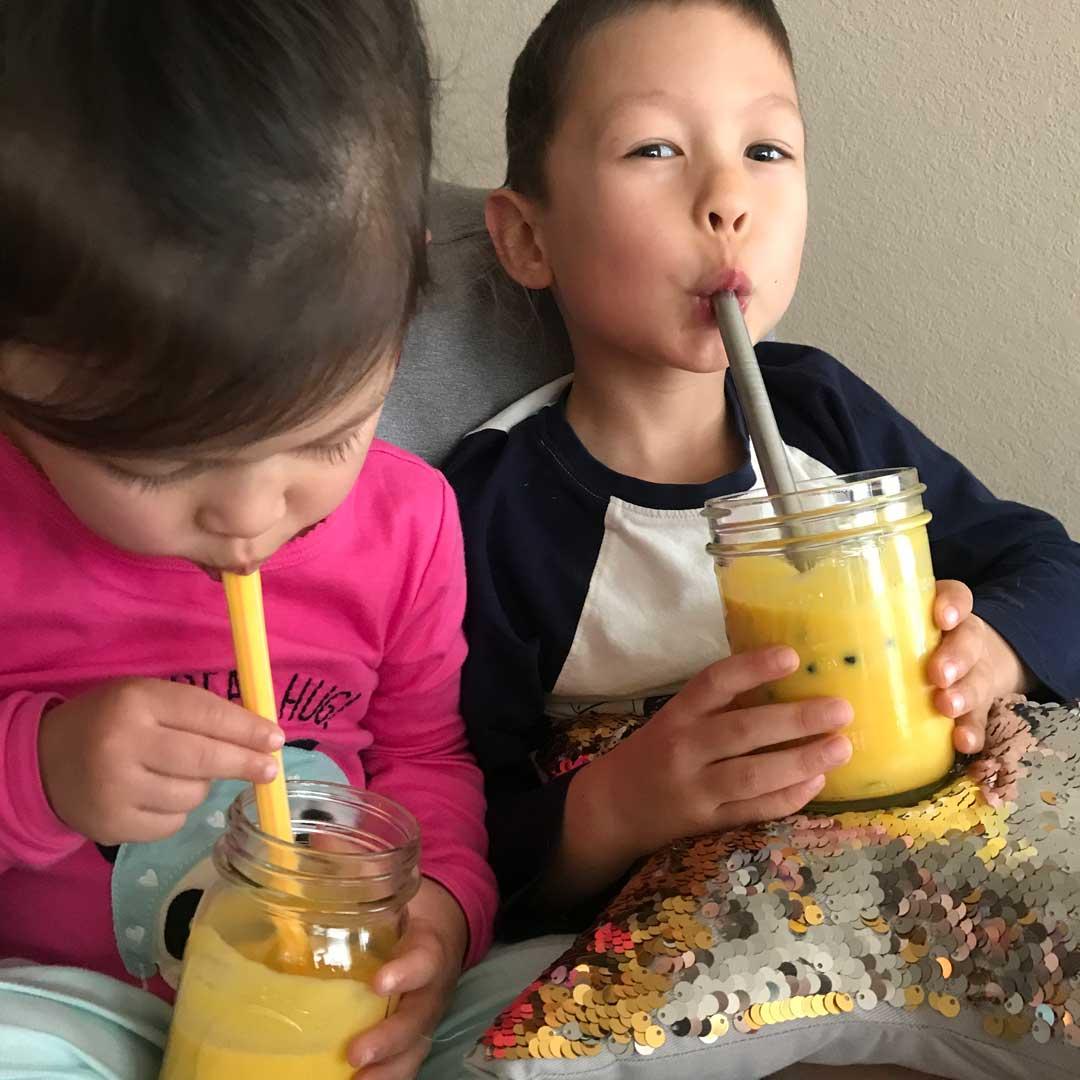 kids drinking mango lassi with boba